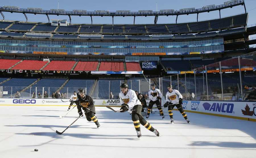 The Boston Bruins practice on the outdoor rink at Gillette Stadium in Foxborough, Mass., Thursday, Dec. 31, 2015, where they will play the Montreal Canadiens in the NHL Winter Classic hockey game on New Year's Day.