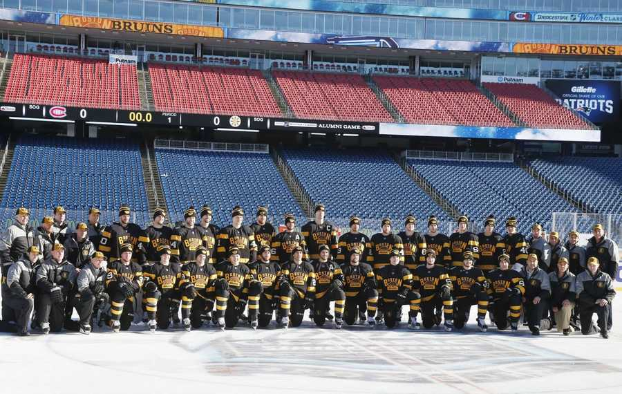 The Boston Bruins pose for a team photo before practice on the outdoor rink at Gillette Stadium in Foxborough, Mass., Thursday, Dec. 31, 2015, where they will play the Montreal Canadiens in the NHL Winter Classic hockey game on New Year's Day.