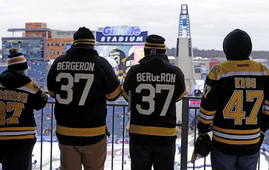 Boston Bruins fans watch the pregame activities prior to the NHL Winter Classic hockey game against the Montreal Canadiens at Gillette Stadium in Foxborough, Mass., Friday, Jan. 1, 2016.
