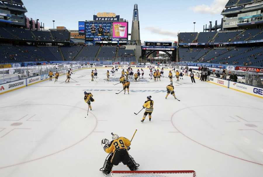 The Boston Pride, foreground, warm up before a women's outdoor hockey game against the Montreal Les Canadiennes at Gillette Stadium in Foxborough, Mass., Thursday, Dec. 31, 2015, where the Boston Bruins will play the Montreal Canadiens in the NHL Winter Classic on Friday.