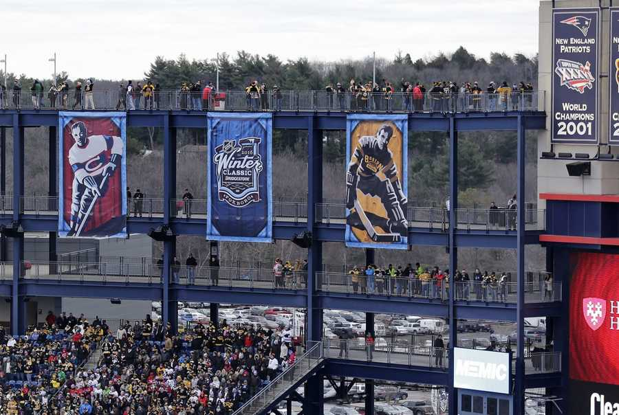 Fans watch the pregame activities prior to the the NHL Winter Classic hockey game between the Boston Bruins and Montreal Canadiens at Gillette Stadium, home of the New England Patriots, in Foxborough, Mass., Friday, Jan. 1, 2016. At top right is the Patriot's 2001 Super Bowl banner.