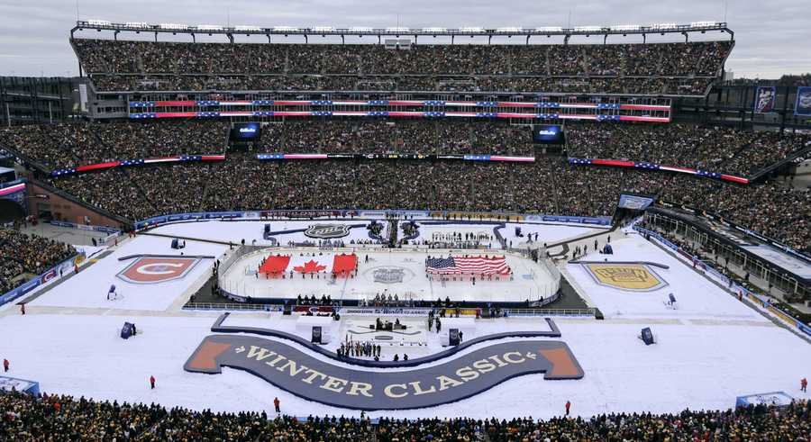 The Canadian and American flags are presented during the national anthems prior the NHL Winter Classic hockey game between the Boston Bruins and Montreal Canadiens at Gillette Stadium in Foxborough, Mass., Friday, Jan. 1, 2016.