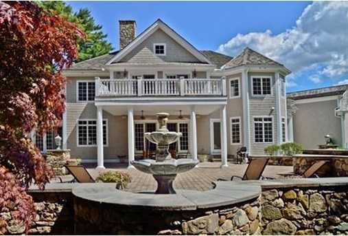 Young,fresh,and exquisitely grand 12 room sophisticated shingle and stone residence set on an impressive park-like setting of almost one acre