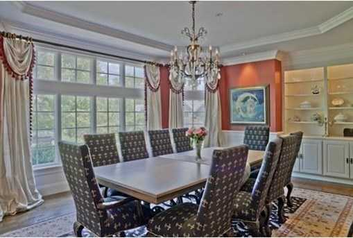 Dining Room has a stunning mahogany Butler's Pantry with dishwasher and wet bar.