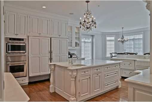 Large open kitchen accented with white marble and stainless appliances