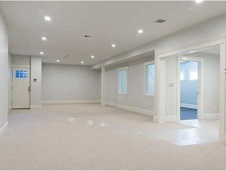 The finished lower level has a large recreation room, an exercise room, a bedroom and full bath.