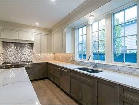 The centrally located kitchen has high end appliances, an island with granite counters & opens to a magnificent family room w/custom built-ins, beamed ceilings and breakfast area that offers access to the patio.