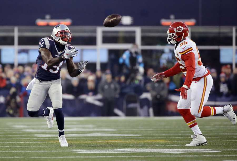 New England Patriots wide receiver Brandon LaFell (19) catches a pass in front of Kansas City Chiefs outside linebacker Dee Ford (55) in the first half of an NFL divisional playoff football game, Saturday, Jan. 16, 2016, in Foxborough, Mass.
