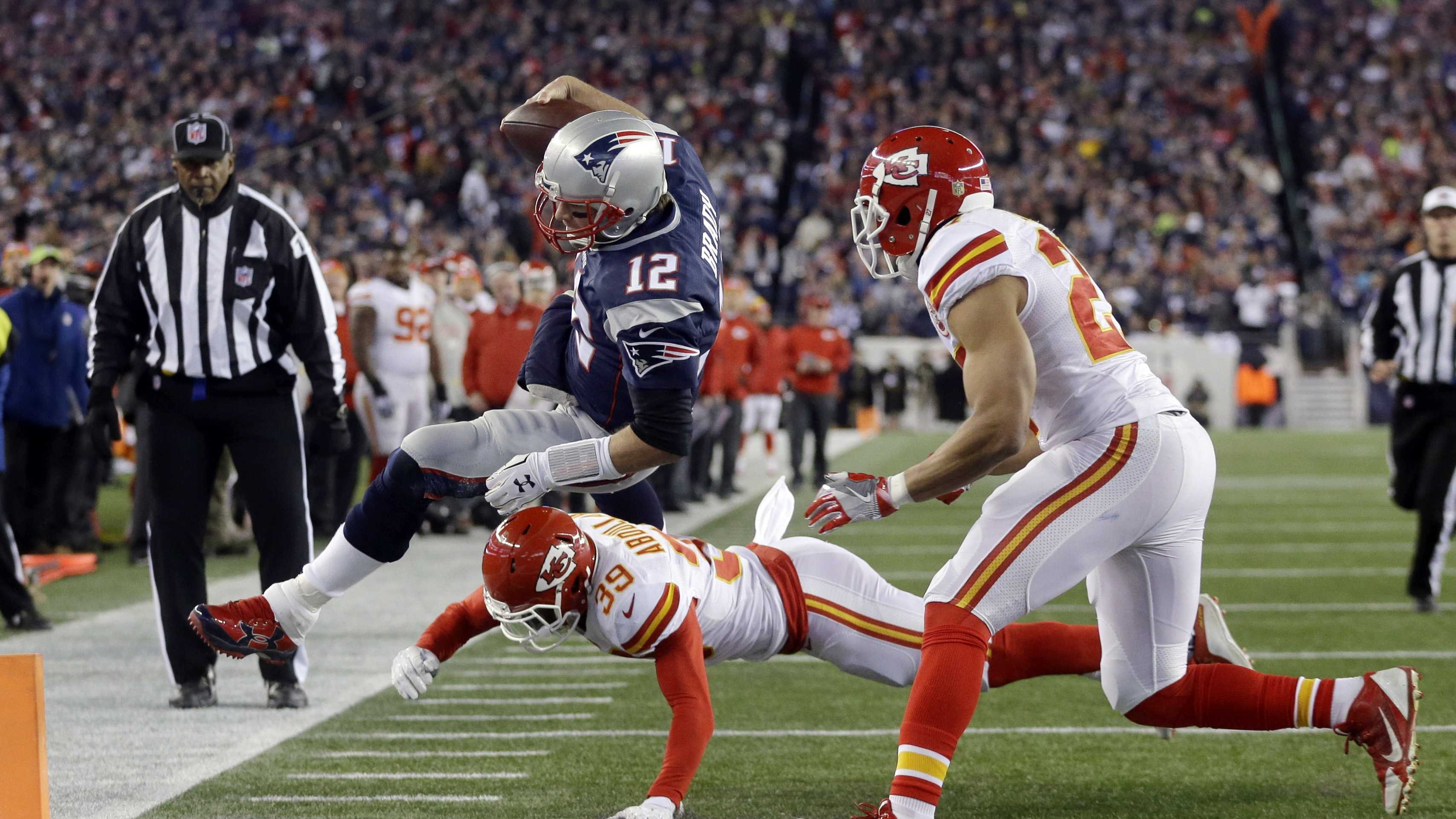 Kansas City Chiefs free safety Husain Abdullah (39) pushes New England Patriots quarterback Tom Brady (12) out of bounds short of the goal line in the first half of an NFL divisional playoff football game, Saturday, Jan. 16, 2016, in Foxborough, Mass.