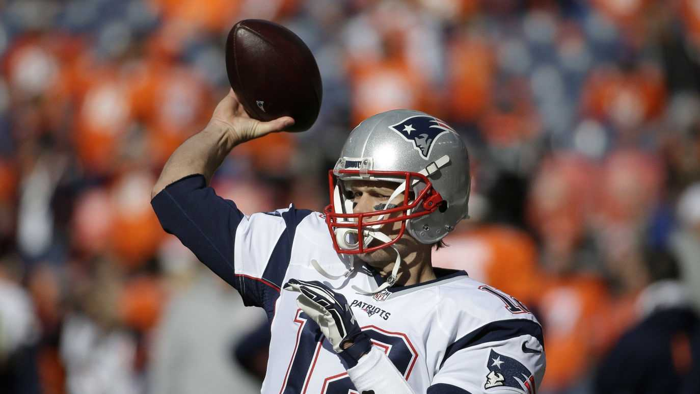 New England Patriots quarterback Tom Brady warms up before the NFL football AFC Championship game between the Denver Broncos and the New England Patriots, Sunday, Jan. 24, 2016, in Denver.