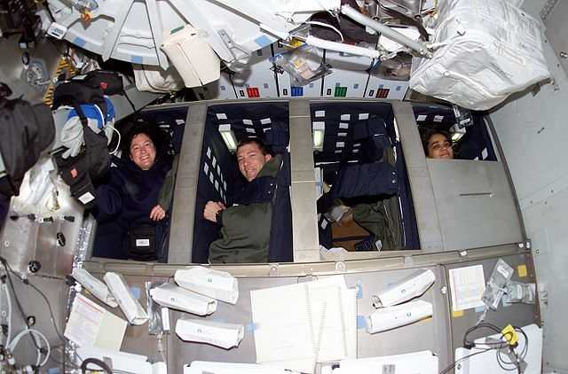 Mission STS-107 crew in bunk beds on the middeck of the Space Shuttle.