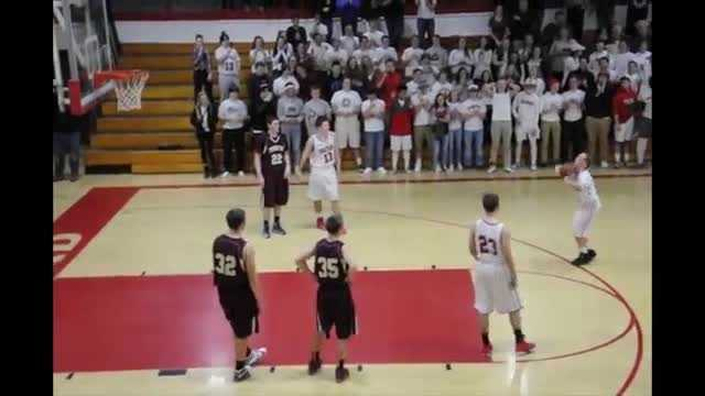 Friday night's basketball game between Sanford and Thornton Academy was close in the final minute -- but there was more important business to attend to. (Video: Paul Auger)