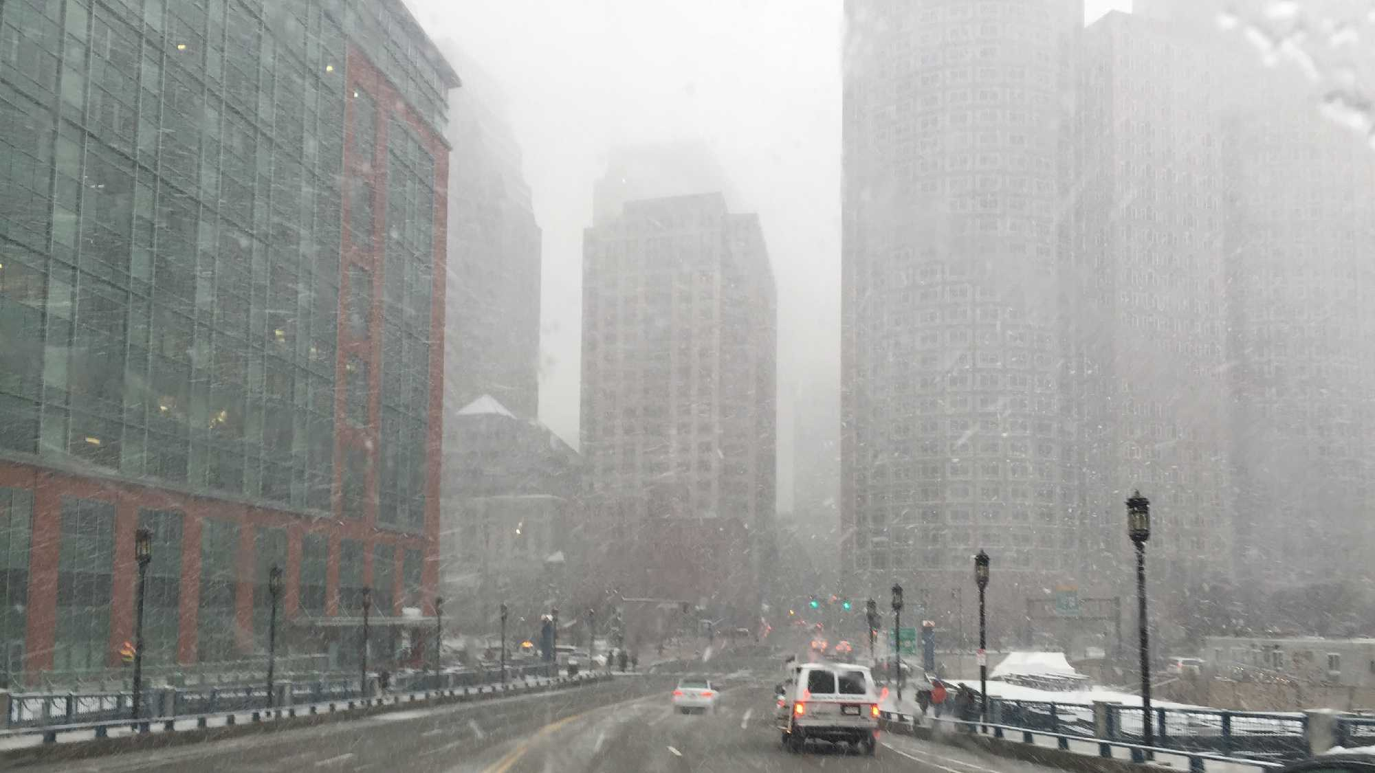 Snow falls in Boston.