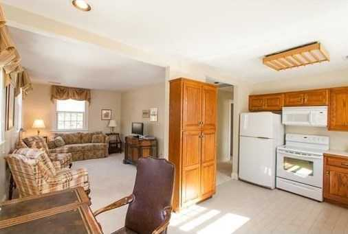 Additional space for guests, extended family, or au pair is available in the private apartment equipped with a kitchen and a brick guest house&#x3B; once an historic schoolhouse.