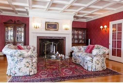 Every room has been painstakingly restored with original showcase details such as beautifully carved fireplace mantels, coffered ceilings, & architectural columns.