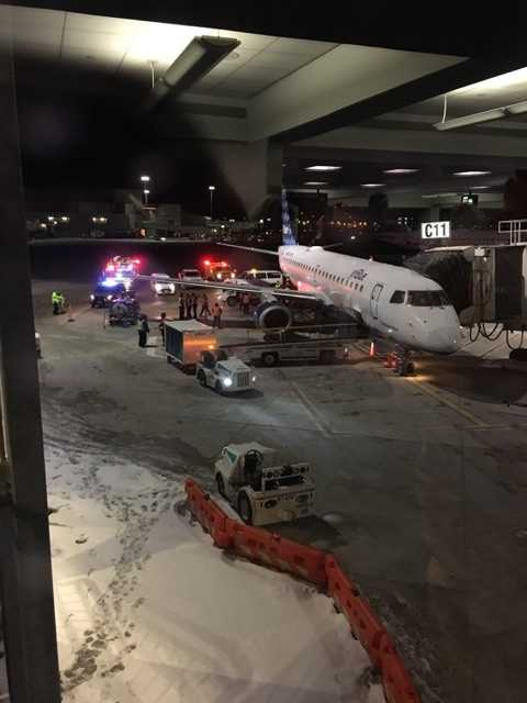 A van struck a JetBlue plane that was parked at a gate at Boston's Logan International Airport early Friday morning.