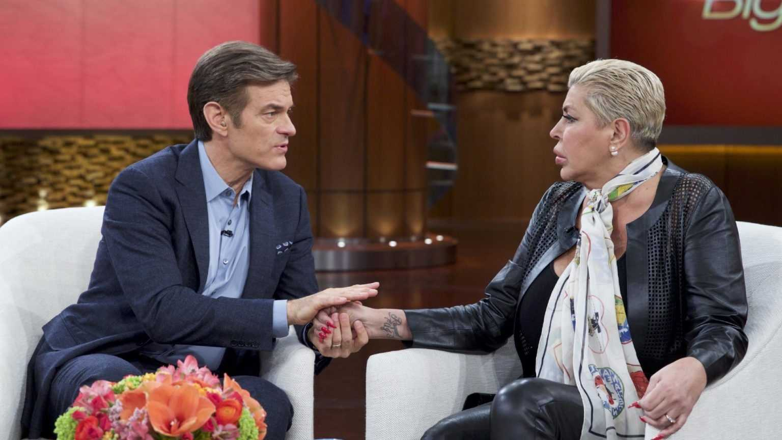 "In this image released by The Dr. Oz Show, Dr. Mehmet Oz, left, comforts Angela ""Big Ang"" Raiola during a taping of ""The Dr. Oz Show,"" in New York. The reality TV star says she veers between hope and depression as she fights stage-four brain and lung cancer. In a tearful interview airing Tuesday, Feb. 16, 2016, on ""The Dr. Oz Show,"" Raiola of ""Mob Wives"" fame said her family is her support and her reason to keep going."