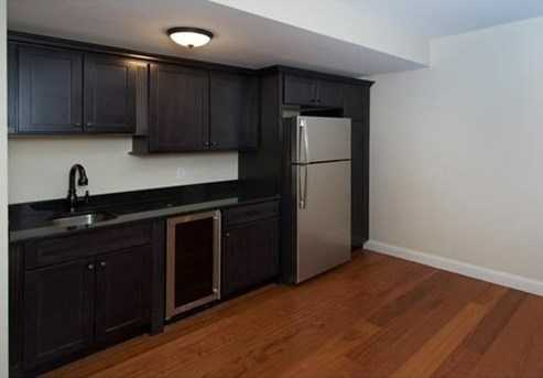 Lower Level Is Huge With Bedroom and Bathroom, Playroom, Media Room, Kitchenette, Exercise Room and 1/2 Bathroom.