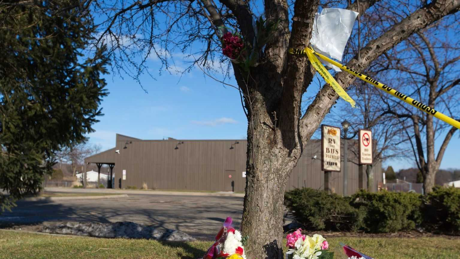 Flowers lie near a makes shift memorial outside a Cracker Barrel, Sunday, Feb. 21, 2016, in Kalamazoo, Mich. According to police a man drove around Kalamazoo fatally shooting several people at multiple locations on Saturday, including the parking lot of the restaurant. Authorities identified the shooter as Jason Dalton.