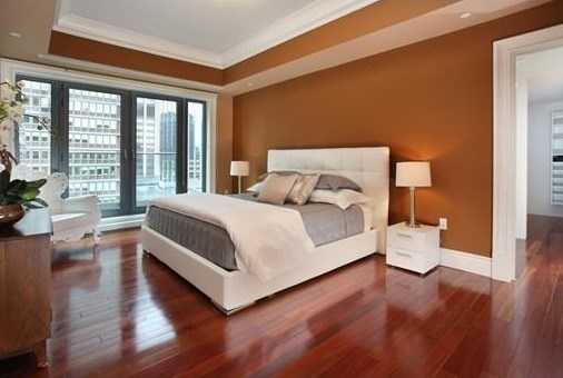 A master bedroom suite has a large walk-in closet with a large laundry room and a spa-like Waterworks bathroom with a double vanity, walk-in shower, and separate soaking tub.