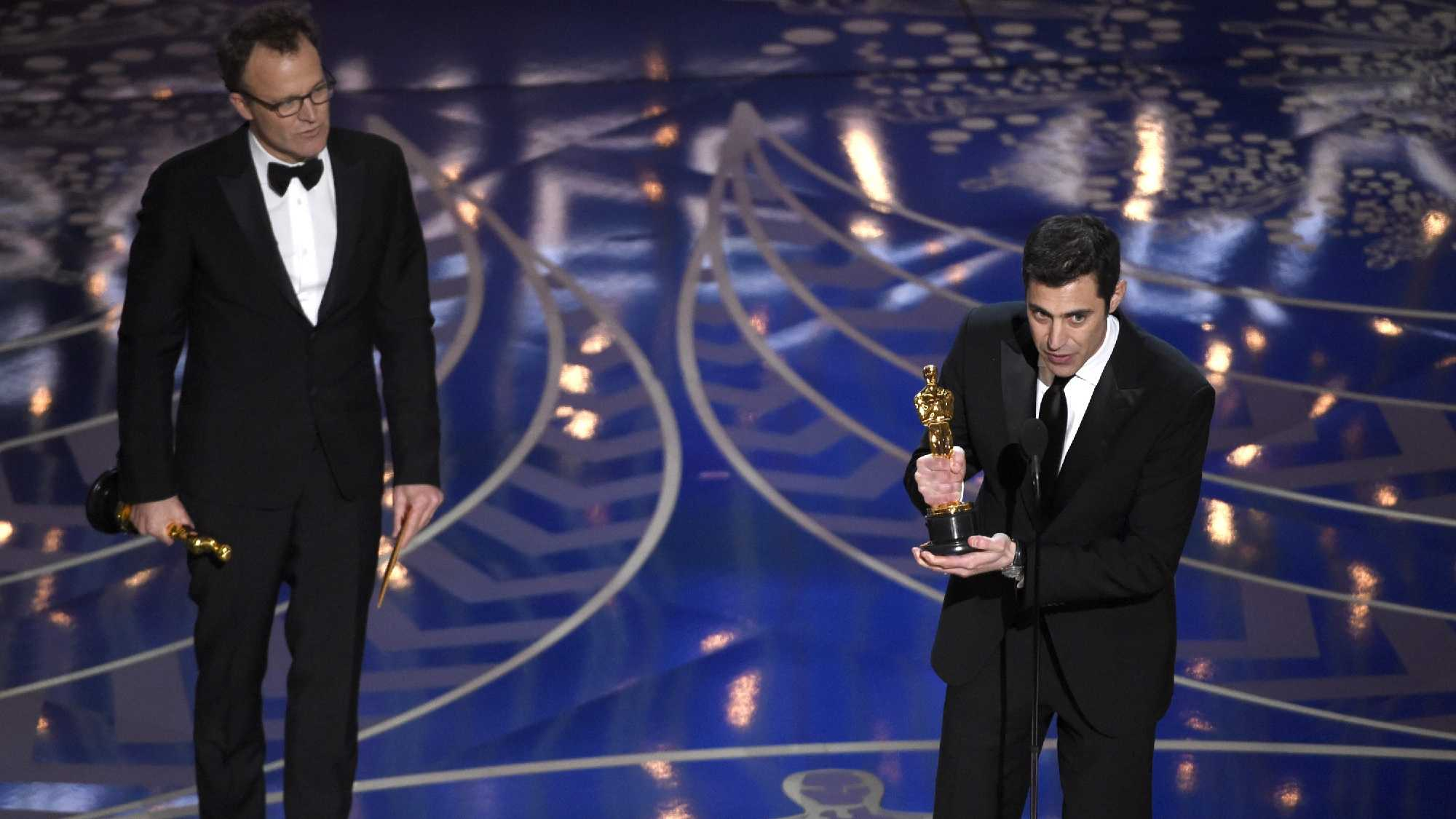 "Tom McCarthy, left, and Josh Singer accept the award for best original screenplay for ""Spotlight"" at the Oscars on Sunday, Feb. 28, 2016, at the Dolby Theatre in Los Angeles."