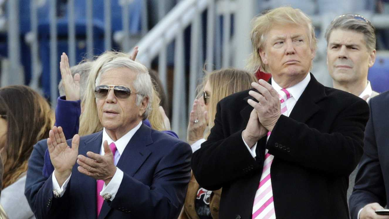New England Patriots owner Robert Kraft, left, and businessman Donald Trump, right, applaud on the field before an NFL football game between the Patriots and the New York Jets in Foxborough, Mass., Sunday, Oct. 21, 2012.