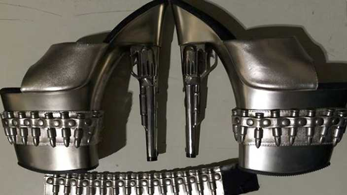 "This Sunday, Feb. 28, 2016 photo released by the Transportation Security Administration shows a pair of gun-shaped stiletto heels at Baltimore-Washington International Thurgood Marshall Airport, in Maryland. A woman had the shoes in her carry-on luggage as she tried to move through security. The agency prohibits passengers from carrying ""replica guns or ammunition"" through airport security checkpoints."