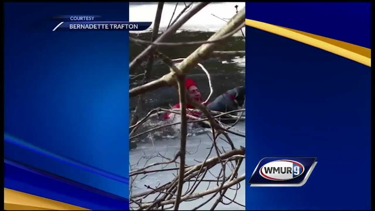 A woman in Derry recorded a video of firefighters rescuing her dog from an icy backyard pond Tuesday.