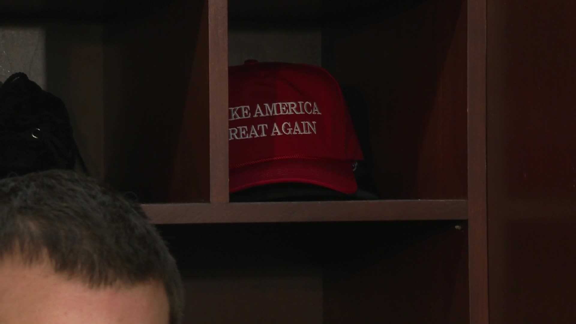 "Donald Trump's ""Make America Great Again"" hat appears in New England Patriots quarterback Tom Brady's locker."