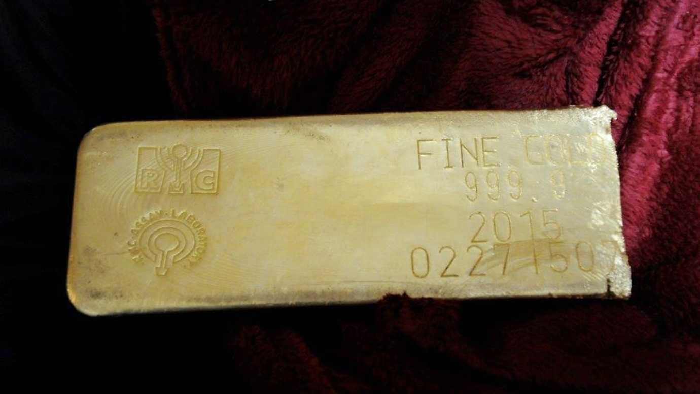 This undated file photo provided by the FBI shows a gold bar that was recovered in Miami from a heist in North Carolina on March 1, 2015. Agents identified the alleged ringleader as Adalberto Perez, who was arrested this week and held without bail Friday, March 4, 2016, on federal robbery and weapons charges. Two accomplices remain at large.