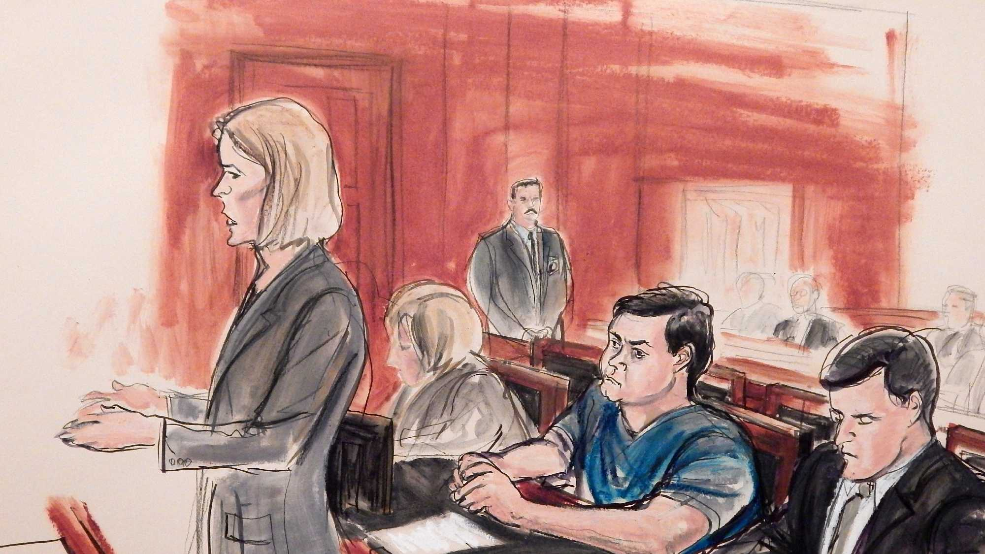 In this Feb. 11, 2015, file courtroom sketch, Assistant U.S. Attorney Anna Skotko, foreground left, addresses the court at the arraignment of Russian citizen Evgeny Buryakov, on charges that he participated in a Cold War-style Russian spy ring in New York. A federal judge refused on Wednesday, July 29 to throw out a spy case against the Russian banker, rejecting arguments that the U.S government was overreaching by prosecuting a defendant who was openly working as an agent of a foreign government. Seated behind Skotko from left are an unidentified Russian interpreter, defendant Evgeny Buryakov and defense attorney Benjamin Naftalis.
