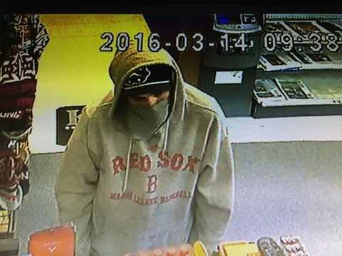 The robber is described as a white man in his 20s to 30s, who is 5 feet, 10 inches to 6 feet tall.