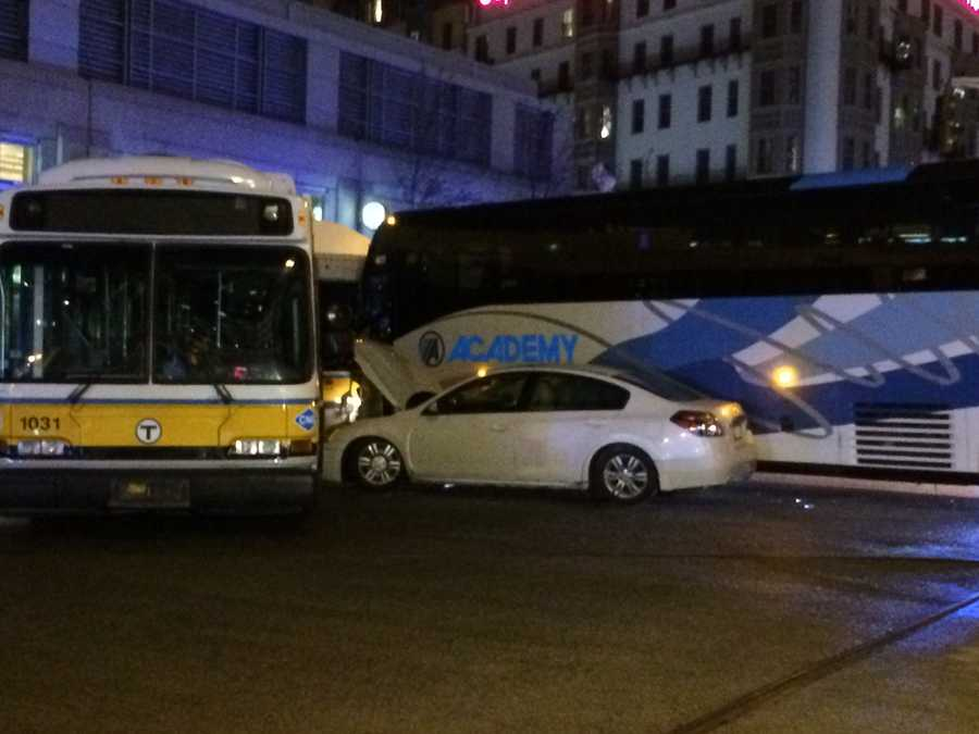 Two buses and a car crashed in Boston on Friday night.