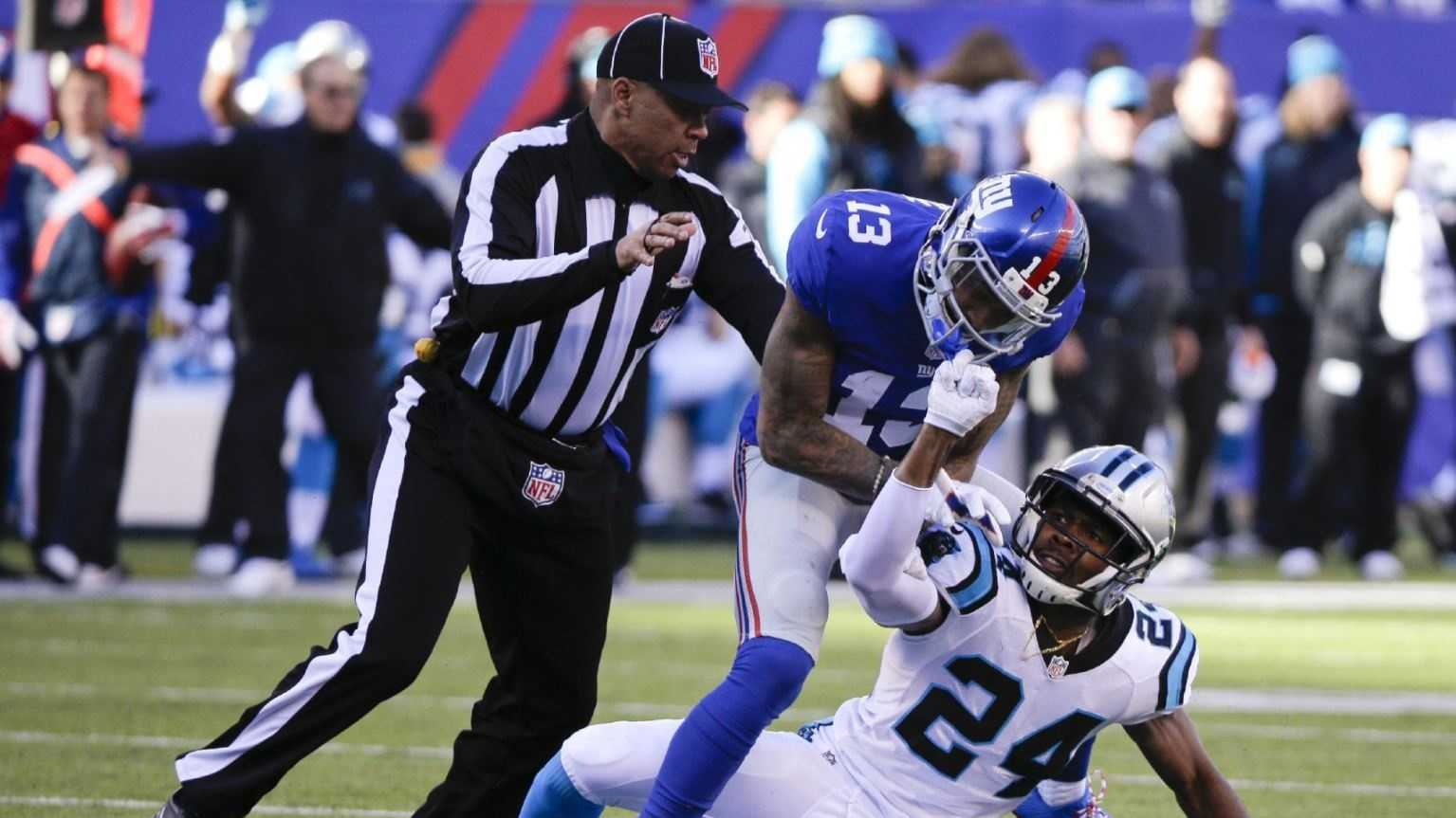 In this Dec. 20, 2015, file photo, a referee, left, separates New York Giants wide receiver Odell Beckham (13) and Carolina Panthers' Josh Norman (24) during the first half of an NFL football game Sunday, Dec. 20, 2015, in East Rutherford, N.J. The NFL's powerful competition committee is recommending making extra point kicks from the 15-yard line permanent, eliminating all chop blocks and ejecting a player for twice receiving certain unsportsmanlike conduct penalties.