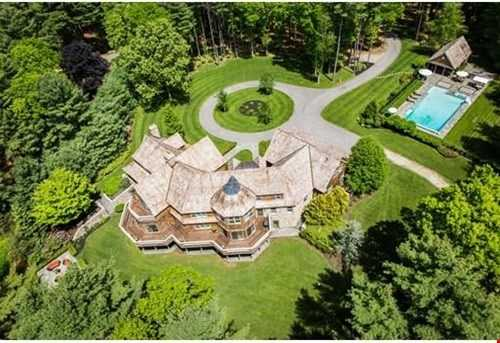 Exquisite 13 acre compound with magnificent North River views perched on lush manicured grounds.