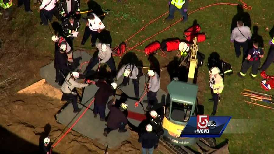 Crews work to rescue man stuck in trench