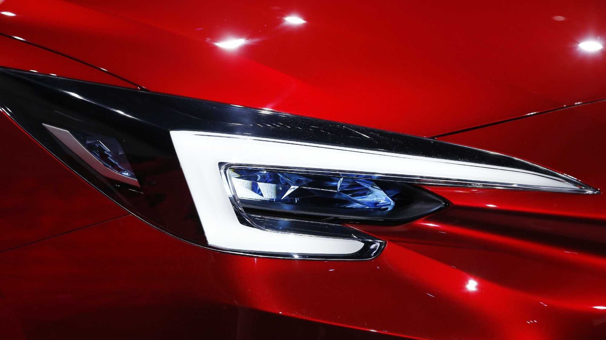 A headlight from the Subaru Impreza Sedan Concept is on display during the Los Angeles Auto Show Wednesday, Nov. 18, 2015, in Los Angeles.