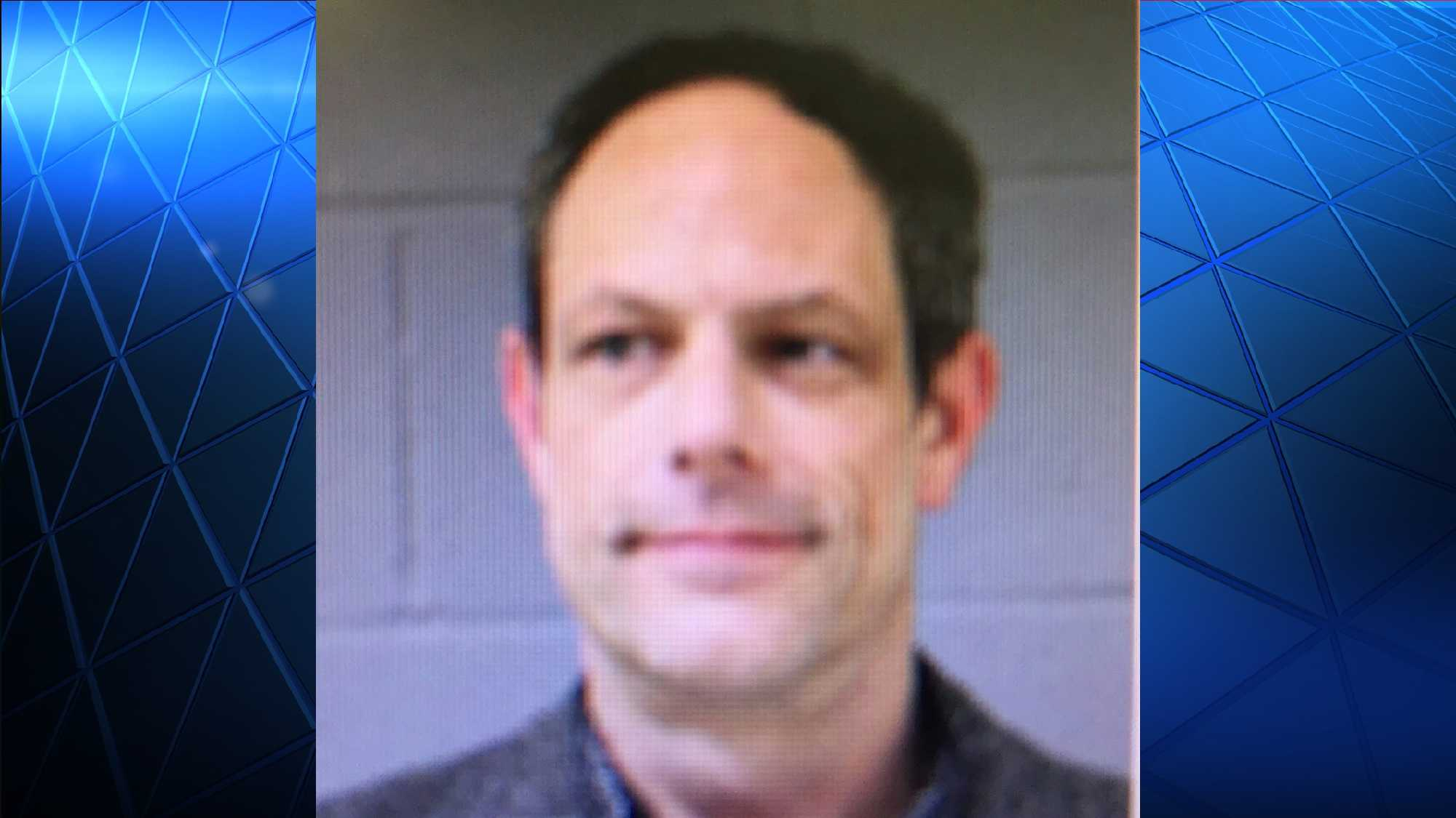 Newtown Police sayJason Adams, had entered the school carrying a concealed firearm.