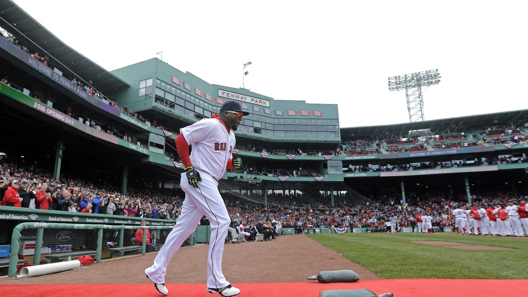 Boston Red Sox designated hitter David Ortiz runs onto the field as he is introduced for the home opener baseball game against the Baltimore Orioles at Fenway Park, Monday, April 11, 2016, in Boston.