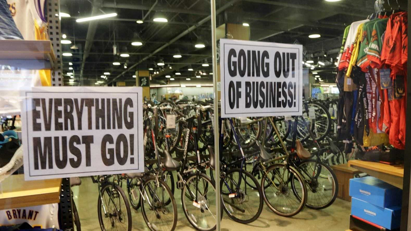 """Going Out Of Business"" and other signs are displayed at a Sport Chalet store in downtown Los Angeles is seen Saturday, April 16, 2016. The Southern California-based chain says it has begun closing all its stores and has stopped selling merchandise online. Founded in 1959, the sporting goods company has about 50 locations in California, Arizona, Nevada and Utah. The company offered no explanation for the closure."