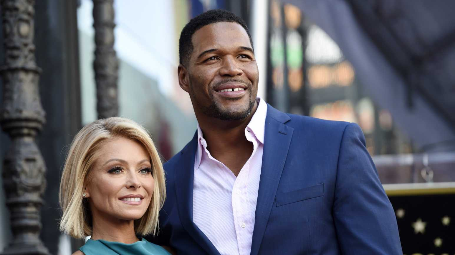 "In this Oct. 12, 2015 file photo, Kelly Ripa, left, poses with Michael Strahan, her co-host on the daily television talk show ""LIVE! with Kelly and Michael,"" during a ceremony honoring Ripa with a star on the Hollywood Walk of Fame in Los Angeles. Ripa was absent from her daytime talk show Wednesday, April 20, 2016, the day after it was announced that Strahan was leaving the show to join ""Good Morning America"" full-time. The show's spokeswoman, Barbara Warren, said that Ripa had a day off."