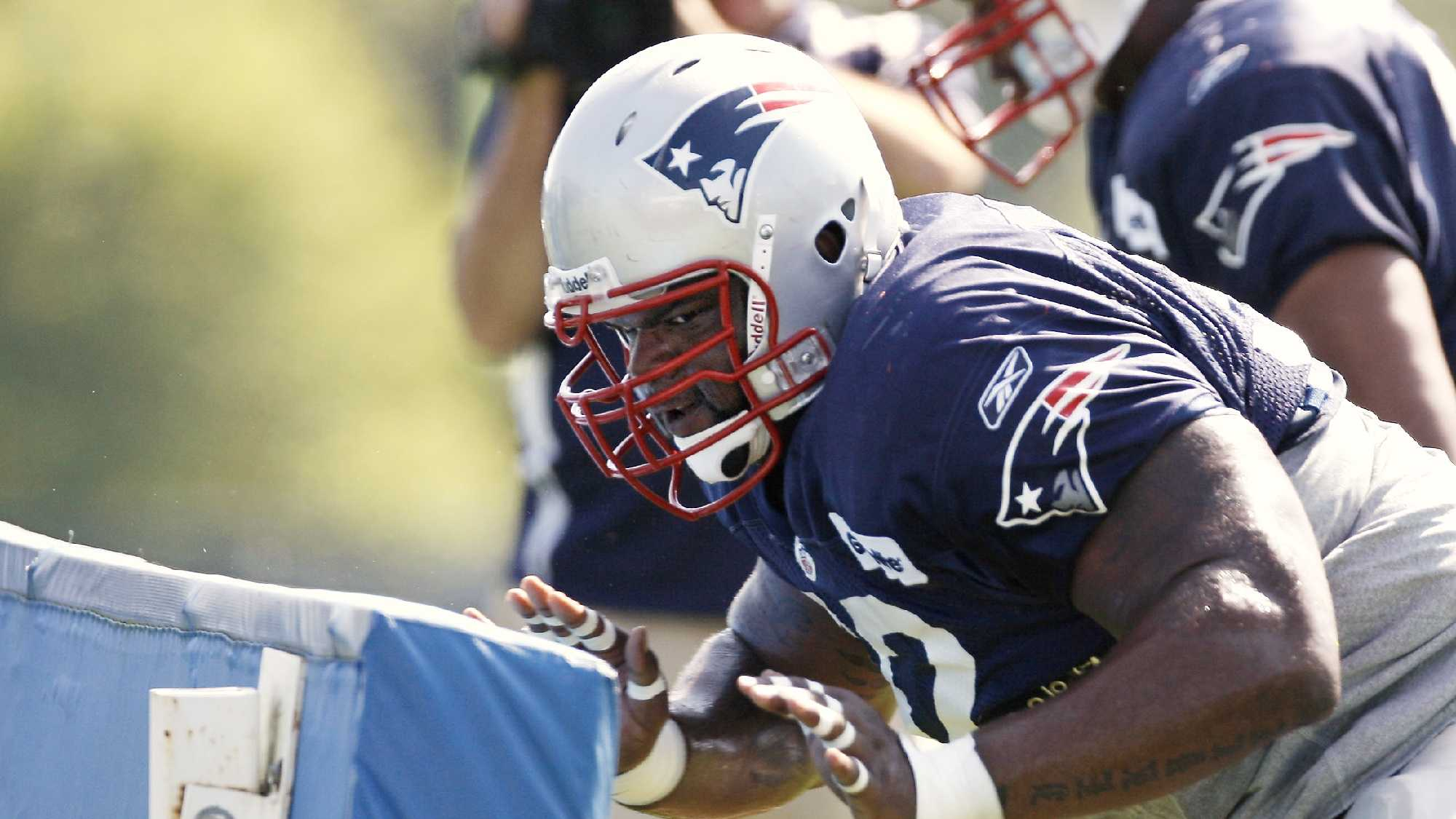 FILE - New England Patriots rookie defensive lineman Ron Brace takes on the blocking sled during NFL football training camp at Gillette Stadium in Foxborough, Mass. Saturday, Aug. 1, 2009.