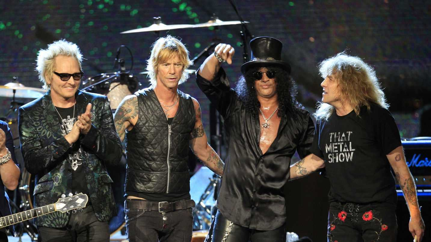In this April 15, 2012 file photo, Guns N' Roses, from left, Matt Sorum, Duff McKagan, Slash and Steven Adler appear on stage at their induction into the Rock and Roll Hall of Fame in Cleveland.