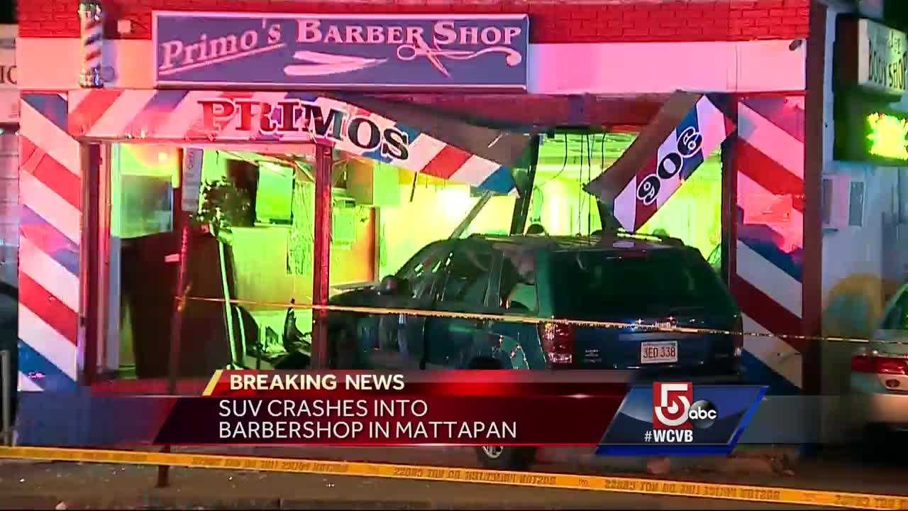 A car ran into a barbershop after sources say the driver ran over men chasing his brother.