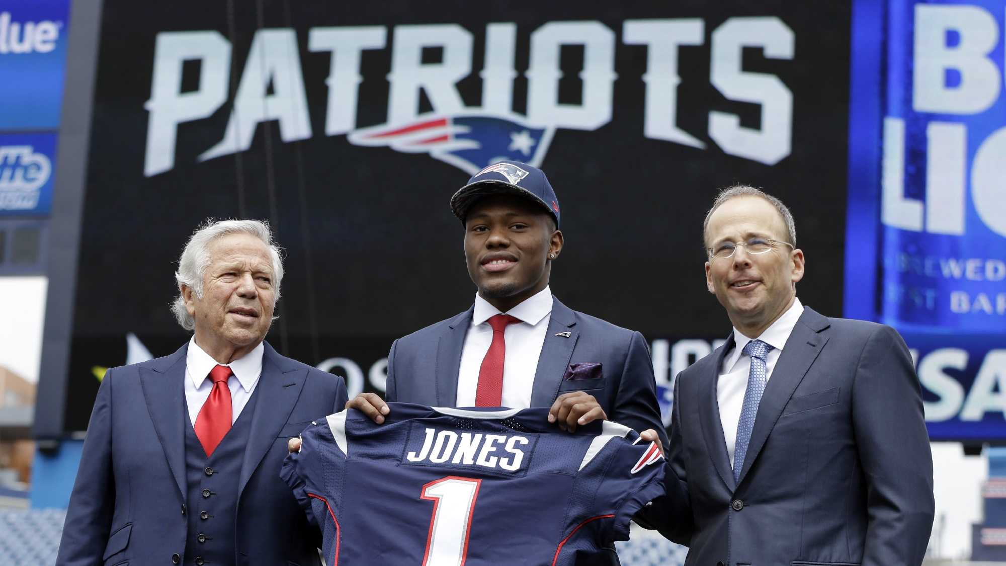 New England Patriots football top draft pick, Cyrus Jones, is introduced by team owner Robert Kraft, left, and team president Jonathan Kraft, right, at Gillette Stadium, Friday, May 6, 2016, in Foxborough, Mass.