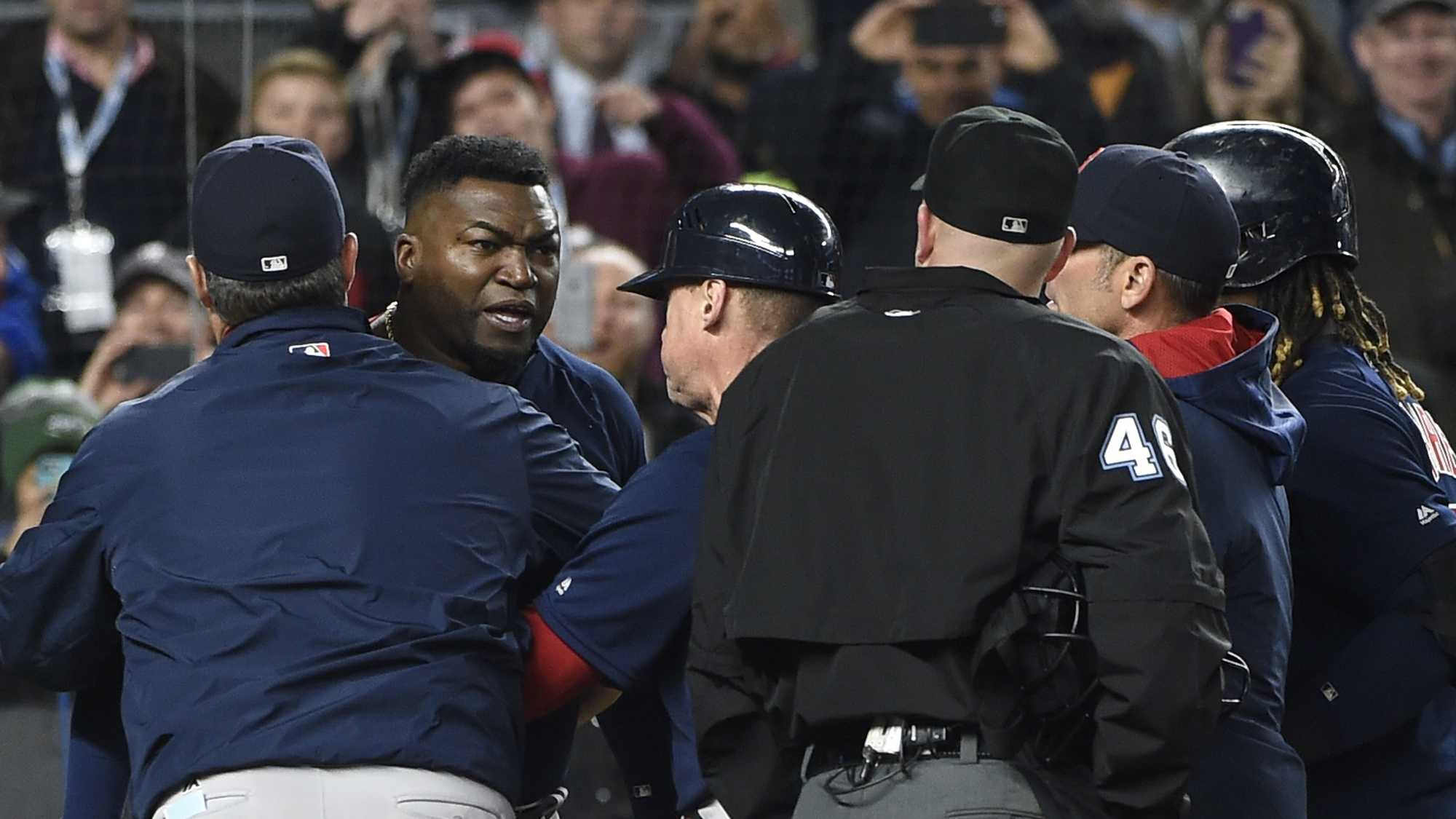 Boston Red Sox manager John Farrell, left, and teammates push designated hitter David Ortiz, second from left, away from umpire Ron Kulpa (46) as Ortiz reacts to a called second strike off of New York Yankees relief pitcher Andrew Miller n the ninth inning of a baseball game, Friday, May 6, 2016, in New York. The Yankees won 3-2. Both Farrell and Ortiz were ejected from the game.