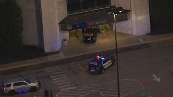 Police said the attacker crashed a car into the front of Macy's department store before the attacker stabbed two people.