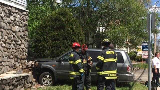 A pregnant driver and a child were sent to a local hospital after a Honda SUV crashed into the front of a Pleasant Street building Sunday afternoon, May 15, 2016, officials said.
