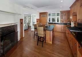 Situated on .57 acres with over 6200 sq. feet of living on 3 full floors.