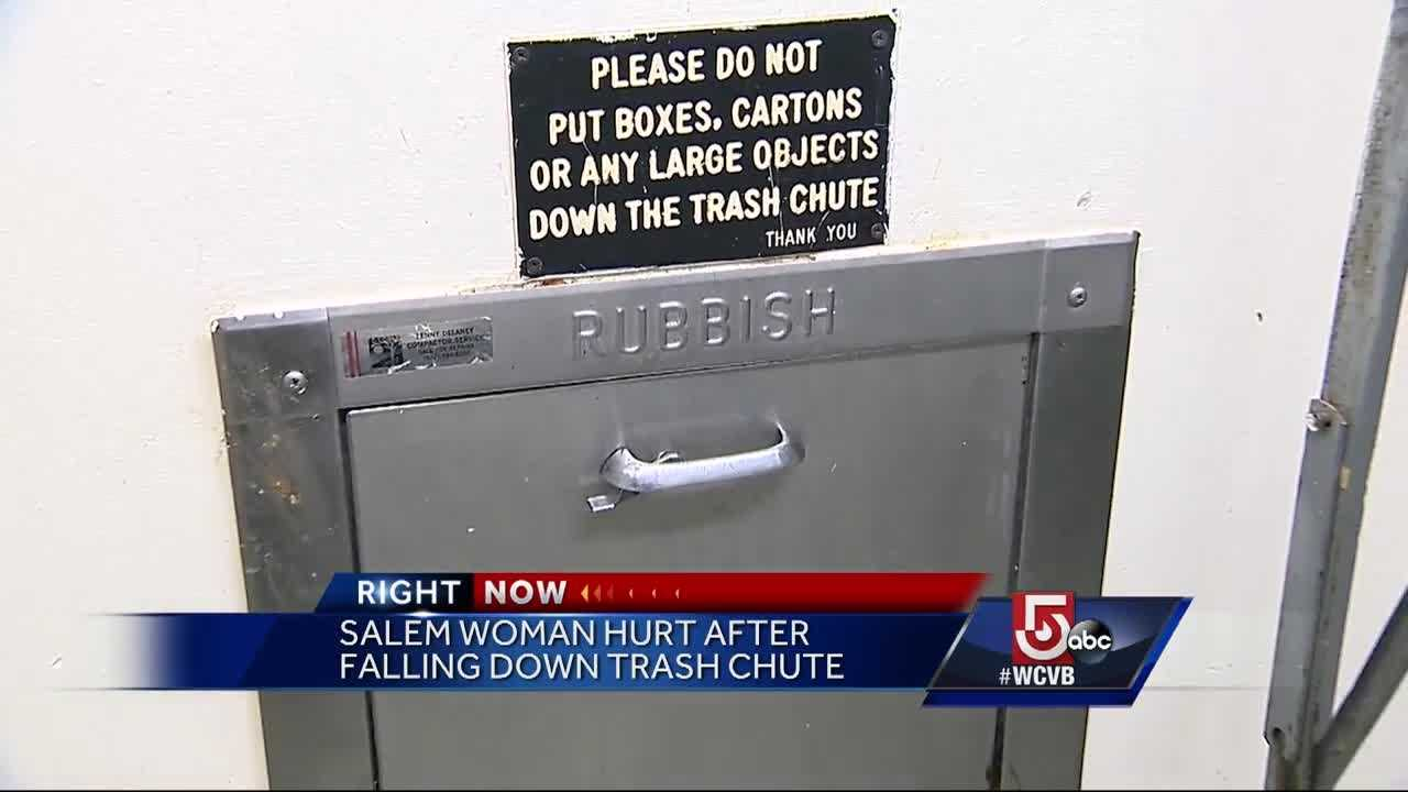 A woman is lucky to be alive after she fell down a trash chute trying to get her key when the trash compactor turned on.